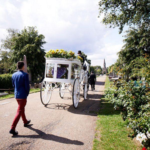 Matt walking behind funeral carriage of Naz