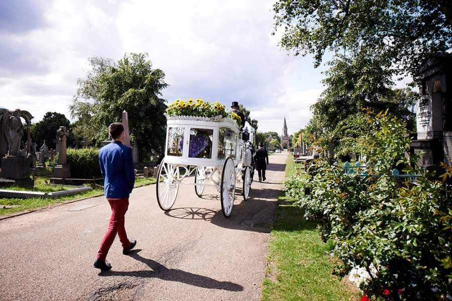 Matt walking behind funeral carriage of Naz